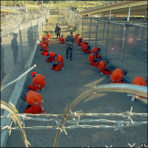 Guantanamo prisoners blindfolded, bound and forced to kneel