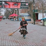 woman-sweeping-the-street