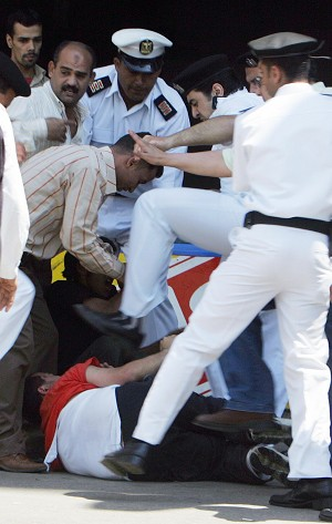Police beating demonstrator in Egypt