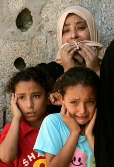 A frightened mother and children in Gaza.